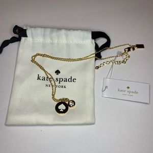 Kate Spade gold necklace.